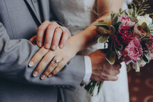Stylish Bridal Couple Together, Hands With Wedding Rings Close Up