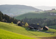 view over the hills of Emmental in spring with farms