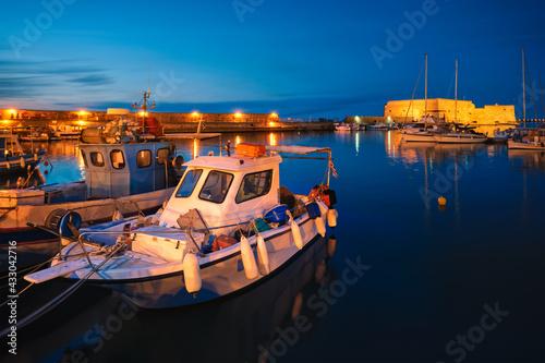 Leinwand Poster Venetian Fort in Heraklion and moored fishing boats, Crete Island, Greece