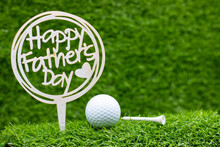 Golf Ball With Happy Father's Day Are On Green Grass