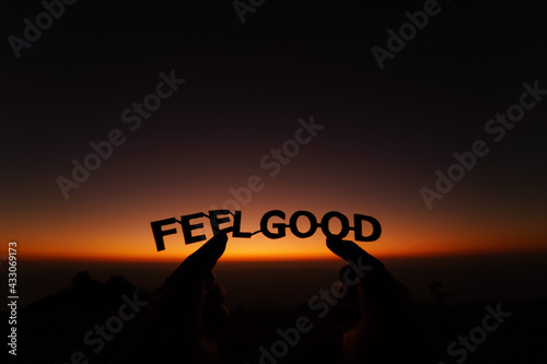 Canvastavla Feel good paper cut text with background sunrise sky.