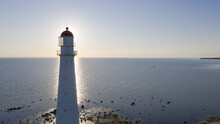 Scenic View Of The Tahkuna Lighthouse In The Background Of The Baltic Sea At Sunrise