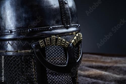 Fotografía Studio shot of iron helmet against dark background