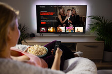 Woman Watching TV Series And Movies Via Streaming Service At Home