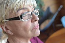 Portrait Of A Sad  Mature Blonde Woman  In Reflexion