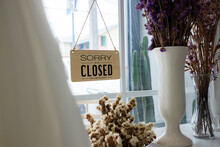 Close Up, Closed Sign Board Hanging On The Door Of Wedding Store Because Due To Viral Infection. Coronavirus 2019 Or COVID-19 And Quarantine Concept. Go Out Of Business