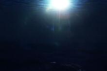 Sun Rays Through Ocean Waves