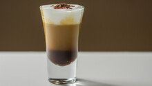 Coffee Drink Shot With A Nutty Note With Fluffy Milk Foam, Decorated With Chocolate Shavings