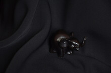 Statuette Of A Black Elephant On A Black Background. Interior Design