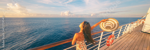 Fototapeta Happy cruise woman relaxing on deck feeling free watching sunset from ship on Caribbean travel vacation. Panoramic banner of sea and boat. obraz