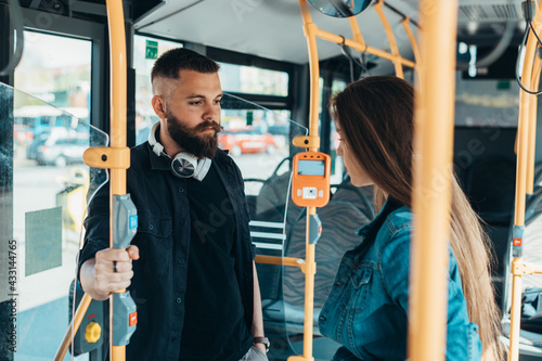 Fotografiet Young couple looking at each other in the bus