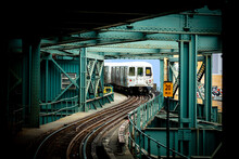 View Of A Train Leaving The Subway Station In Queens, New York City