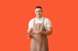 Leinwandbild Motiv Young man cutting fresh pepper on color background