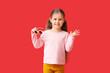Leinwandbild Motiv Cute little girl with stylish sunglasses on color background