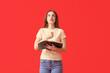 Leinwandbild Motiv Young woman with Bible on color background