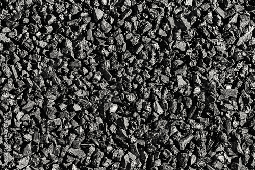 Wallpaper Mural Close-up activated carbon texture. Coconut charcoal.