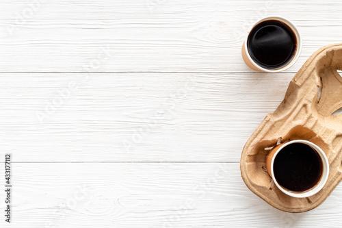 Obraz Coffee to go background. Black coffee in paper cups, top view - fototapety do salonu