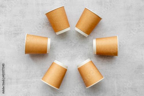 Obraz Paper cups pattern. Take away coffee or tea cups, top view - fototapety do salonu