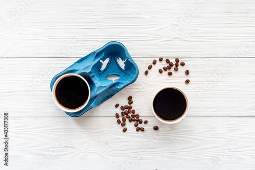 Obraz Flat lay of black coffee in paper cups with beans - fototapety do salonu