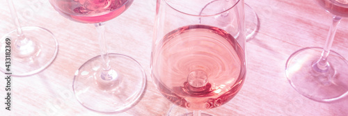 Obraz Rose wine panorama, toned in pink. Various wineglasses at a tasting - fototapety do salonu
