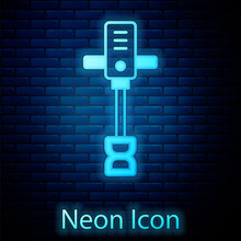 Glowing Neon Electrical Hand Concrete Mixer Icon Isolated On Brick Wall Background. Handheld Electric Cement Mixer. Vector