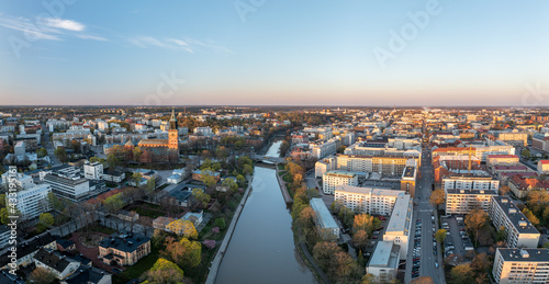 Fotografiet Aerial panorama of Turku city center, Cathedral of Turku and Aura river in spring in Finland