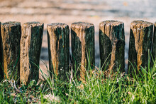 Log Short Fence With Green Grass.background.Close Up