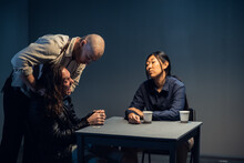 A Suspect In A Police Station Laughs Madly During An Interrogation Conducted By Investigators