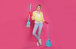 Leinwandbild Motiv Young housewife with broom and dustpan on pink background