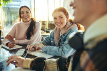 Cheerful Group Of Students In A High School