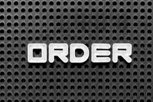 White Alphabet Letter In Word Order On Black Pegboard Background