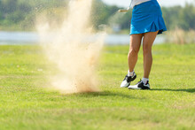 Close Up Legs Golfer.  Golfer Sport Course Golf Ball Fairway. People Lifestyle Woman Playing Game Golf And Hitting Out Of Sand Trap Go On Green Grass. Asia Female Player Game Shot In Summer