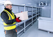Leinwandbild Motiv Refrigeration Chamber for Food Storage. Metal Shelves and Racks for String Frozen Foods. Food Freezing Shop. Selective Storage System. Cold Warehouse. Air conditioning on a warehouse wall.