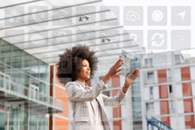 Businesswoman Looking On Map Over Futuristic Transparent Digital Tablet With Icons Around Outdoors