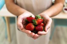 Man Holding Fresh Strawberries In Kitchen