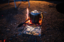 Kettle On Camping Stove At Night