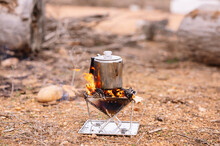 Kettle On Camping Stove At Ground