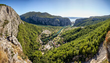 Croatia, Dalmatia, Omis, Settlement Situated At Forested Bank Of Cetina River In Summer