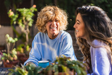 Cheerful Mother And Daughter At Back Yard