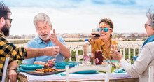 Happy Family Having Lunch During Sunny Day