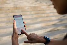 Sportswoman Setting Timer On Smart Phone