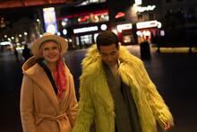 Portrait Fashionable Couple On City Street At Night