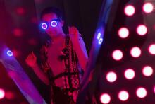 Portrait Fashionable Young Man In Futuristic Neon Glasses At Nightclub