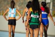 Female Track And Field Athletes Walking On Sunny Track