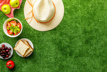 Top View Of Picnic Basket With Red Tablecloth And Fresh Summer Food