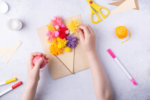 Small Child Doing A Bouquet Of Flowers Out Of Coloured Paper And Coloured Knitting Balls For Mom. Simple Gift Idea. View Top, Copy Space