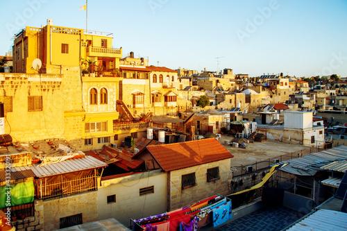 Fotografie, Obraz sunrise and rooftops of old town of Jerusalem