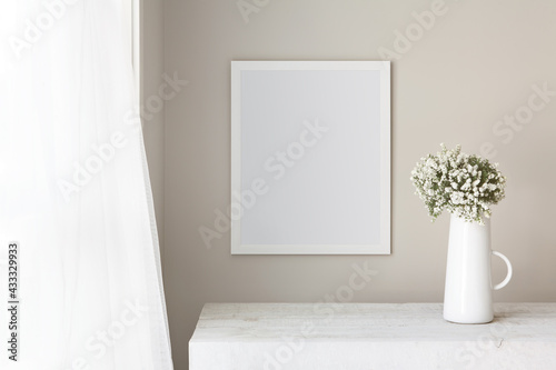 Canvas-taulu 16x20 thin white vertical frame mockup template, hanging on a neutral coloured wall, next to an open window on a summers day