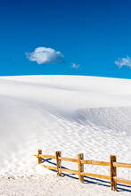 White Sand Dune Slowly Swallowing Wooden Fence