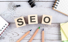 SEO Text On Wooden Block With Office Tools On Wooden Background